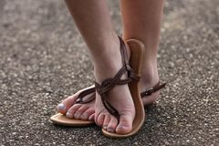 Sandals and feet Royalty Free Stock Photos