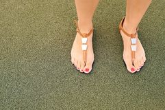Sandals on feet Royalty Free Stock Images