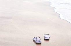 Sandals flip flops on the beach Royalty Free Stock Photos