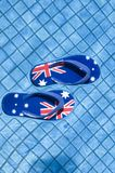 Sandals Floating in a Pool IV. Pair of sandals printed with the Australian flag floating on a pool Royalty Free Stock Images