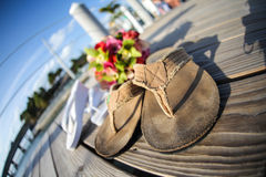 Sandals and flowers on walkway Stock Images