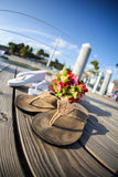 Sandals and flowers on walkway Stock Photography