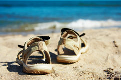 Sandals going to swim. Sandals going for a swim in the sea Stock Images