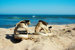 Sandals going to swim. Sandals going for a swim in the sea Stock Photo