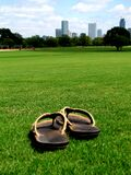 Sandals on grass Stock Photos