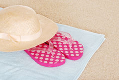 Sandals hat on a beach towel Stock Image