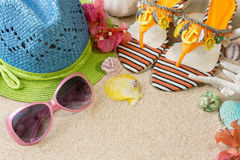 Sandals, hat and sunglasses on the sand. Summer beach concept Stock Photo
