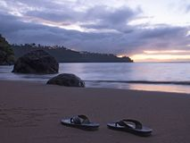 Sandals on Hawaiian Tropical Beach at Sunset royalty free stock photos