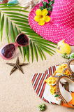 Sandals, heat and sunglasses on the sand. Summer beach concept. Sandals, heat and sunglasses and shells on the sand. Summer beach concept Royalty Free Stock Image