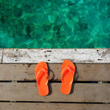 Sandals at jetty Royalty Free Stock Image