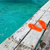 Sandals at jetty Royalty Free Stock Photos