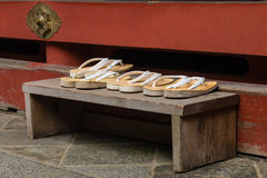 Sandals left outside Buddhist shrine Royalty Free Stock Photography