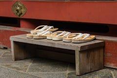 Sandals left outside Buddhist shrine royalty free stock photography