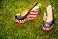 Sandals, lie on the grass in the garden Royalty Free Stock Images