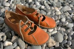 Free Sandals On A Pebbled Beach Royalty Free Stock Photos - 4425878