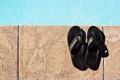 Sandals at the Pool Royalty Free Stock Image