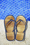 Sandals at the pool Royalty Free Stock Photo