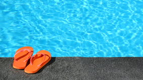 Sandals by a pool Royalty Free Stock Image