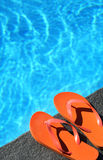 Sandals by a pool Stock Photography
