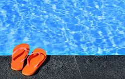 Sandals by a pool. Photo of pair sandals by a pool Stock Images