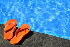 Sandals by a pool Stock Image