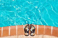 Sandals by a pool Stock Images