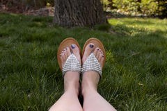 Sandals relaxing in grass Royalty Free Stock Image