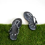 Sandals with rhinestones on green grass. View from above. Isolat Stock Photo