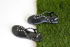 Sandals with rhinestones on green grass. View from above. Isolat Stock Images