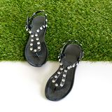 Sandals with rhinestones on green grass. View from above. Isolat Royalty Free Stock Photo