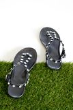 Sandals with rhinestones on green grass. View from above. Isolat Royalty Free Stock Photography