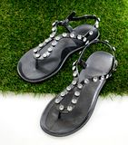 Sandals with rhinestones on green grass. Royalty Free Stock Photos
