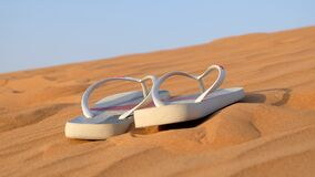 Sandals on sand Stock Photos