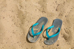 Sandals on sand. Beach Sandals on Sand background stock images
