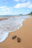 sandals on sand beach in relax and vacation summer time, Trang Thailand Royalty Free Stock Image
