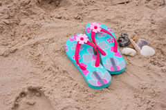 Sandals sand Stock Images