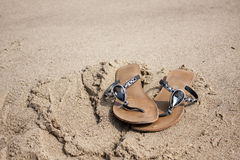 Sandals on sand Stock Photo