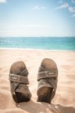 Sandals in the sand of a tropical beach Royalty Free Stock Photos