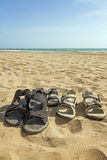 Sandals at a sandy beach Stock Photo