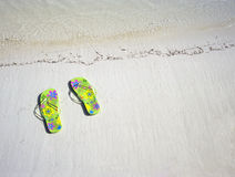 Sandals by the sea Stock Photography