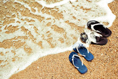 Sandals sea shore Stock Image