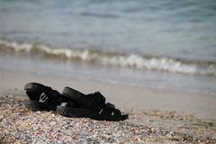 Sandals by the sea Stock Photos