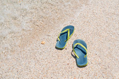 Sandals by the shore Stock Photos