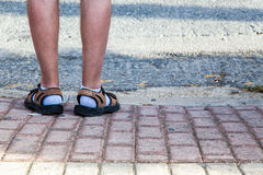 Sandals and socks. Funny unstyilish feet covered with socks and sandals Stock Photos
