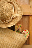 Sandals in sun purse. Pair of sandals hanging out of wicker purse royalty free stock photo