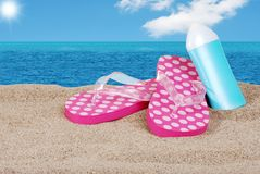 Sandals and suntan lotion on a sunny day Royalty Free Stock Photo