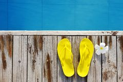 Sandals by a swimming pool Stock Images