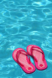 Sandals by a swimming pool Royalty Free Stock Photo