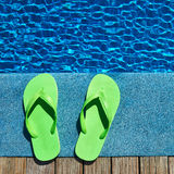 Sandals by a swimming pool Royalty Free Stock Images