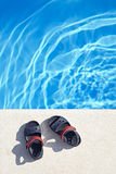 Sandals at the swimming pool Royalty Free Stock Photography